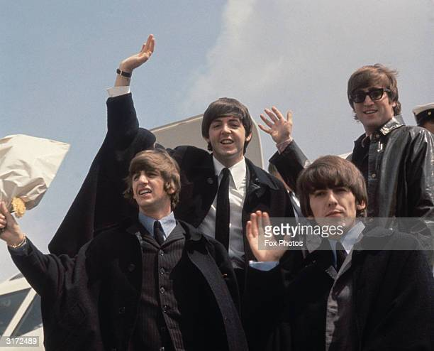 The Beatles from left to right John Lennon George Harrison Paul McCartney and Ringo Starr arrive back at London Airport after their Australian tour