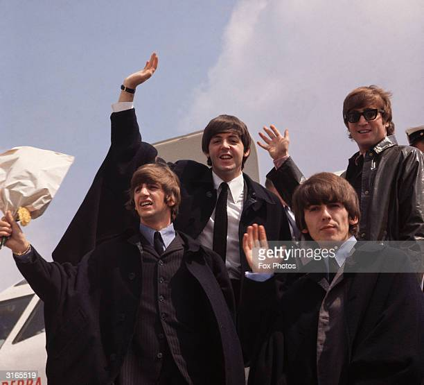 The Beatles John Lennon George Harrison Paul McCartney and Ringo Starr pictured on their arrival in London following a tour of Australia
