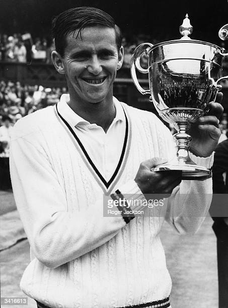 Australian tennis player Roy Emerson holding the Wimbledon trophy after winning the mens' singles at Wimbledon He beat compatriot Fred Stolle 62 64 64