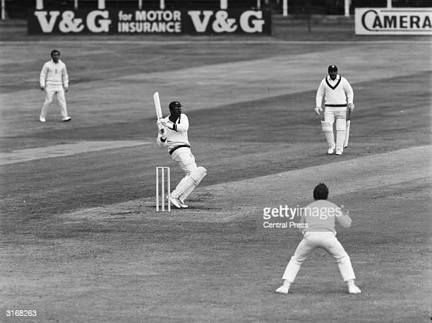 West Indian cricketer Clive Lloyd hits D Brown for a six to make 50 during the first innings in the second England vs Rest of The World Test match at...
