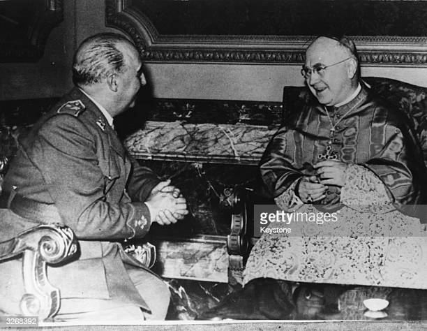Francis Cardinal Spellman Archbishop of New York talks with General Franco when they met at the Pedralbes Palace Barcelona Spain The palace is a...