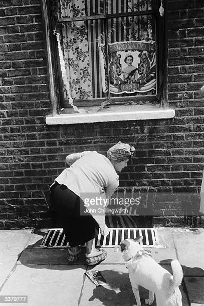 A flag in the window of a house in Morpeth Street in London's East End commemorates the coronation of Queen Elizabeth II Original Publication Picture...