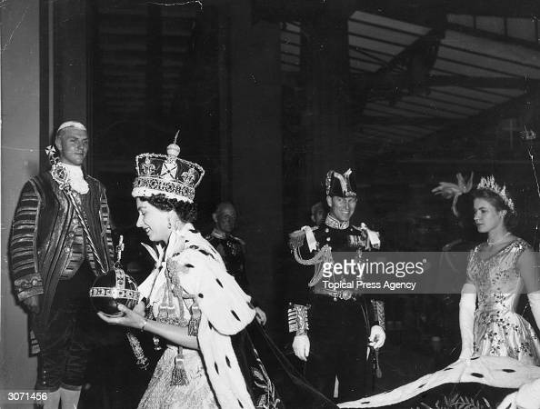 Queen Elizabeth II wearing the Imperial State crown and carrying the Orb and Sceptre returns to Buckingham Palace from Westminster Abbey London...