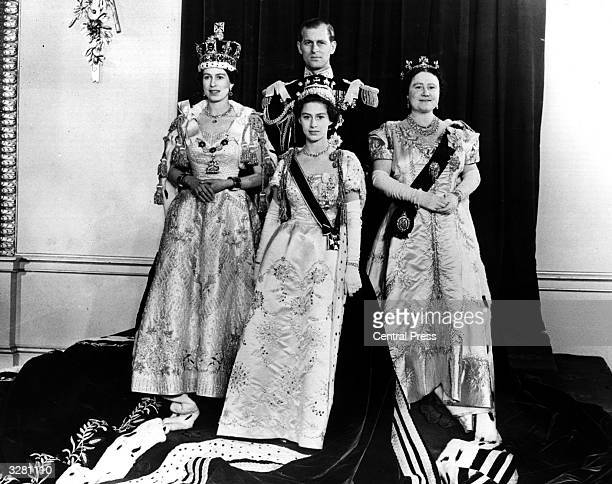 Queen Elizabeth II with her husband The Duke of Edinburgh Queen Elizabeth the Queen Mother and Princess Margaret Rose in the throne room of...