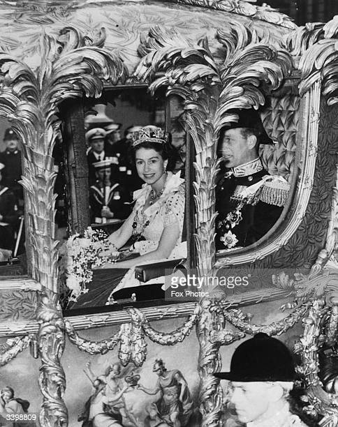 Queen Elizabeth II with The Prince Philip Duke of Edinburgh looking out from her Coronation Coach en route to Westminster Abbey for Coronation...