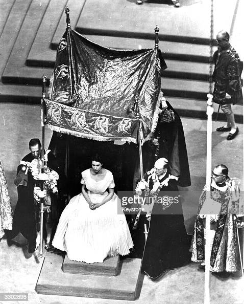 The canopy is placed over the Queen for the anointing ceremony during her coronation