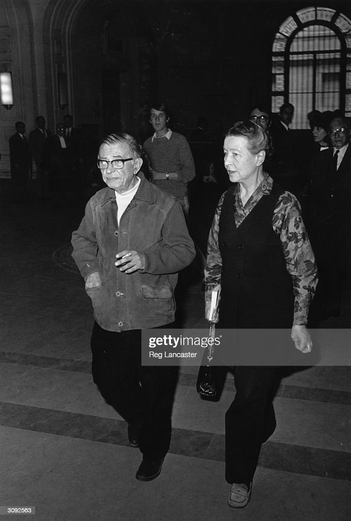 Author, dramatist and novelist, Jean Paul Sartre (1905 - 1980) and existentialist writer and a winner of the Prix Goncourt, Simone de Beauvoir (1908 - 1986) leaving the Palais de Justice in Paris.