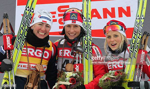 2nd Justyna Kowalczyk of Poland 1st Marit Bjoergen of Norway and 3rd Therese Johaug of Norway pose after the women's 10km Cross Country Skiing during...