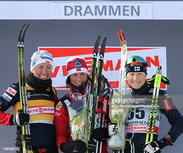 2nd Justyna Kowalczyk of Poland 1st Marit Bjoergen of Norway and 3rd Aino Kaisa Saarinen of Finland pose after the women's 10km classic of the FIS...