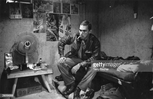 2nd Lieutenant Franc Barringer sitting on his bed in camp in Vietnam
