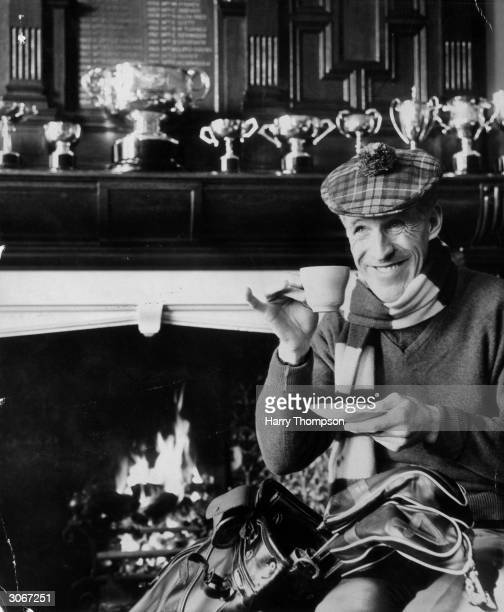 Wearing a tartan cap TV comedian and golf fanatic Bruce Forsyth takes a cup of tea in a clubhouse