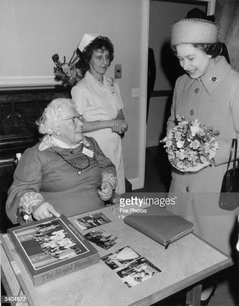 Queen Elizabeth II of Great Britain talking to Isabel Lewis a resident of the Sue Ryder Home in Snettisham Norfolk