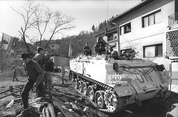 A UN British battalion FV432 armoured personnel carrier escorting humanitarian aid from Zenica to Tusla through 'bomb alley' an area regularly...