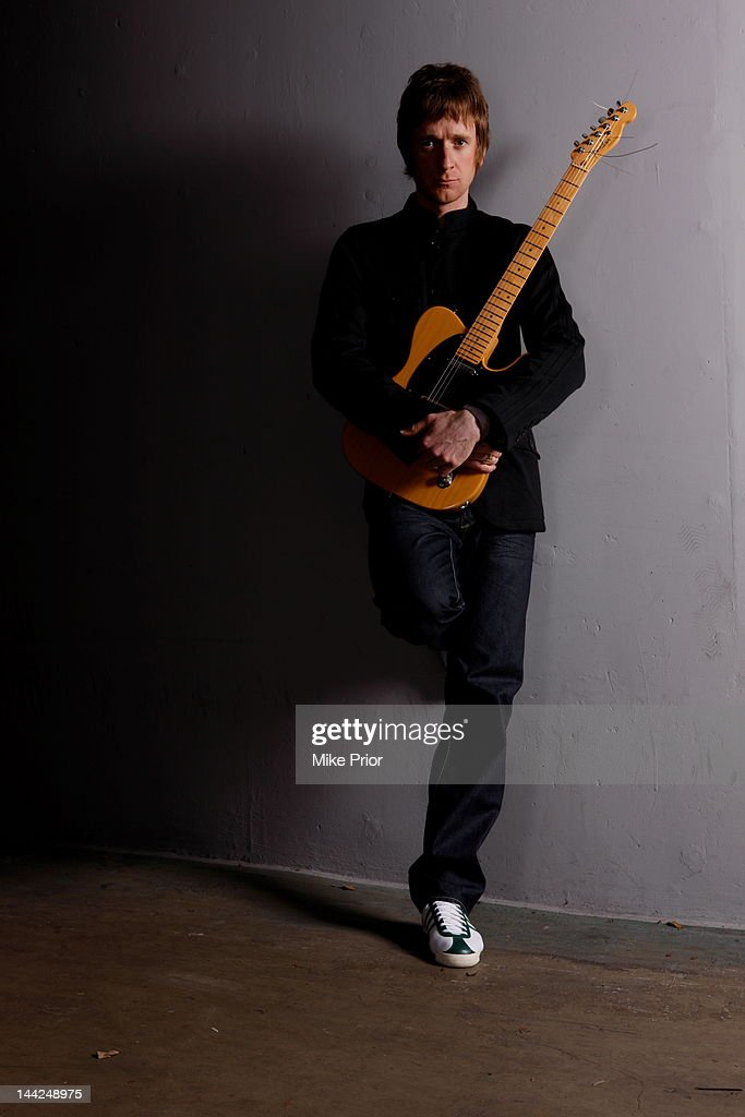 British cyclist Bradley Wiggins posed holding a Telecaster guitar at the Velodrome in Manchester, England on 2nd March 2009.