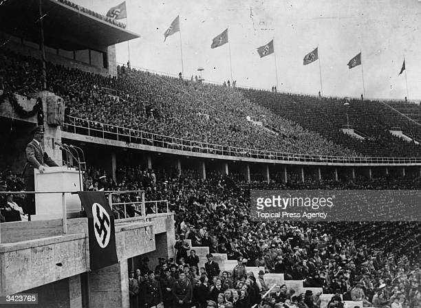 Adolf Hitler addressing thousands of supporters at a Nazi Rally held in the Berlin Stadium on May Day