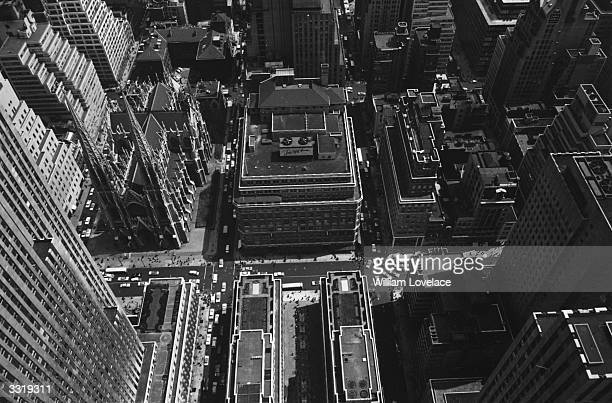 A bird's eye view of New York from the Rockefeller Center with St Patrick's Cathedral dwarfed by the surrounding buildings