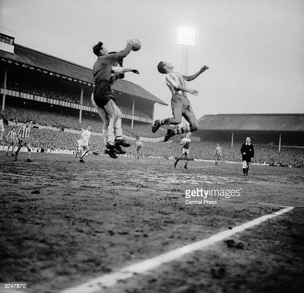 Tottenham Hotspur keeper Brown jumps for the ball during an attack by OFK Belgrade player Skoblar during the semi final of the European CupWinners'...