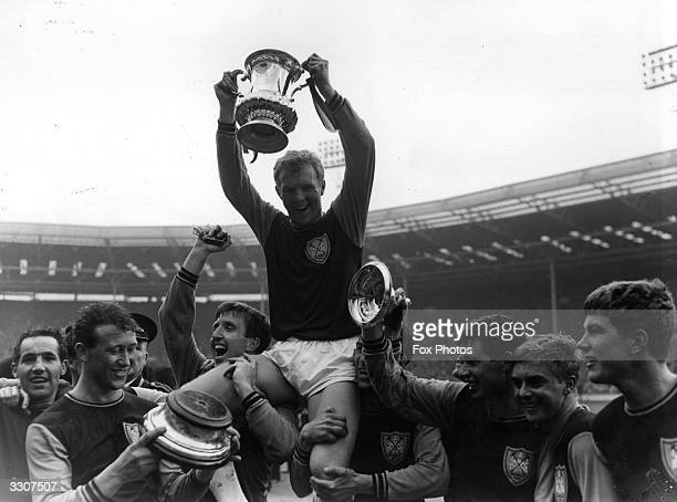 West Ham United captain Bobby Moore is carried aloft by his team mates as he lifts the FA Cup trophy in celebration of their 32 victory over Preston...