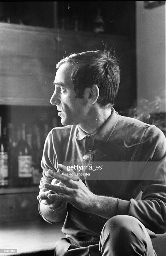 Singer songwriter Charles Aznavour relaxes with a cigarette