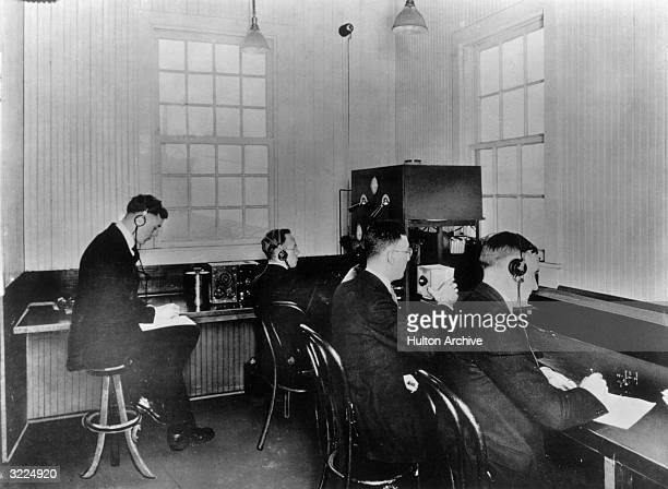 The broadcast staff of KDKA Radio reporting on the Harding Cox election returns in the station Pittsburgh Pennsylvania The station's coverage gave...