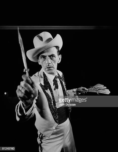 2nd November 1962 Wearing a cowboy hat and embroidered jacket Elizhad from the Collins Knife Throwing Act concentrates on the job in hand