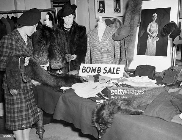 Bargain hunters looking at sale items in the board room of a London dressmakers in Hanover Square The firm were forced from their usual premises by...