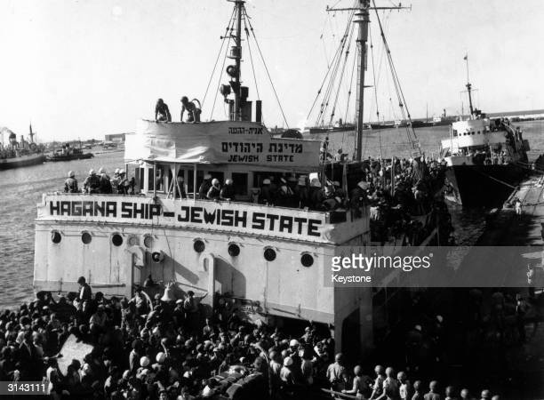The ship 'Jewish State' docking at the port in Haifa with around 2600 refugees on board In the background is the 'Geulah' also loaded with refugees...