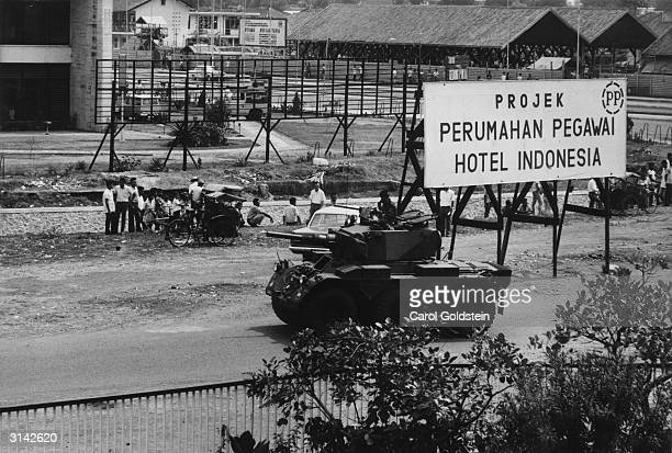 Indonesian troops prepare to open fire on the remaining raiders who participated in the previous day's communist abortive coup in Jakarta Indonesia