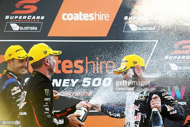 2nd place Garth Tander driver of the Holden Racing Team Holden Commodore VF 1st place Jamie Whincup driver of the Red Bull Racing Australia Holden...
