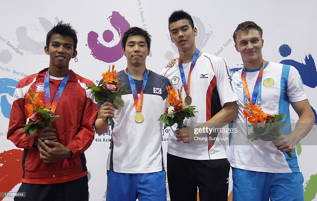 2nd place runner up Sidiq Triady Fauzi of India, 1st place winner Yang Jung-Doo of South Korea, 3rd place Chang Kuo Chi of Chinese Taipei and Azaryev Yevgenly of Kazakhstan pose on the podium after the medals ceremony of the Men's 50m Freestyle final during day two of the 4th Asian Indoor & Martial Arts Games at Dowon Aquatics Center on June 30, 2013 in Incheon, South Korea.