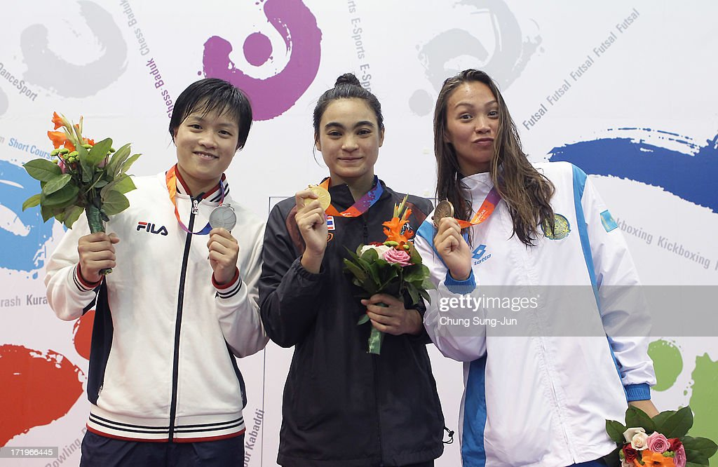 2nd place runner up Sze Hang-Yu of Hong Kong, 1st place winner Srisa Ard Jenjira of Thailand and 3rd place Elmira Aigaliyeva of Kazakhstan pose on the podium after the medals ceremony of the Women's 50m Freestyle final during day two of the 4th Asian Indoor & Martial Arts Games at Dowon Aquatics Center on June 30, 2013 in Incheon, South Korea.