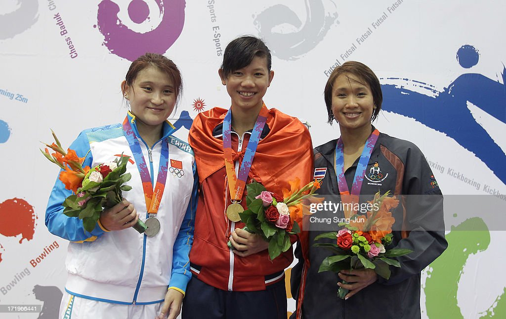 2nd place runner up Yanxin Zhou of China, 1st place winner Nguyen Thi Ahn Vien of Vietnam and 3rd place Natthanan Junkrajang of Thailand pose on the podium after the medals ceremony of the Women's 200 Individual final during day two of the 4th Asian Indoor & Martial Arts Games at Dowon Aquatics Center on June 30, 2013 in Incheon, South Korea.