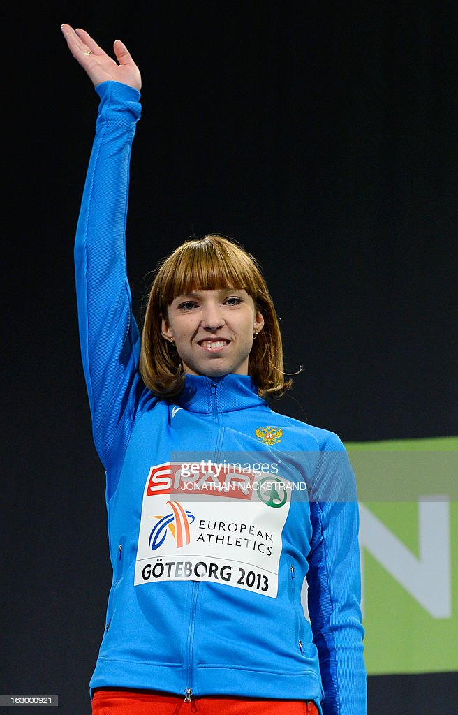 2nd place Russia's Yelena Kotulskaya celebrates after the women's 800m final on the podium at the European Indoor athletics Championships in Gothenburg, Sweden, on March 3, 2013.