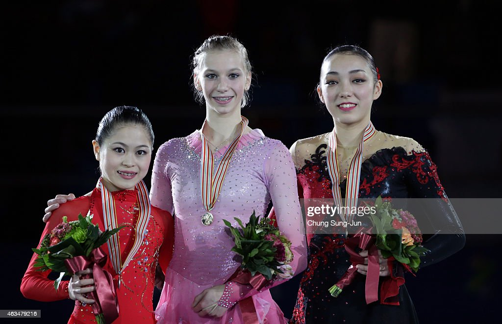 2nd place <a gi-track='captionPersonalityLinkClicked' href=/galleries/search?phrase=Satoko+Miyahara&family=editorial&specificpeople=10090666 ng-click='$event.stopPropagation()'>Satoko Miyahara</a> of Japan, 1st place <a gi-track='captionPersonalityLinkClicked' href=/galleries/search?phrase=Polina+Edmunds&family=editorial&specificpeople=11711394 ng-click='$event.stopPropagation()'>Polina Edmunds</a> of USA and 3rd place <a gi-track='captionPersonalityLinkClicked' href=/galleries/search?phrase=Rika+Hongo&family=editorial&specificpeople=10092257 ng-click='$event.stopPropagation()'>Rika Hongo</a> of Japan pose on the podium after the medals ceremony of the Ladies Singles Skating on day four of the ISU Four Continents Figure Skating Championships 2015 at the Mokdong Ice Rink on February 15, 2015 in Seoul, South Korea.