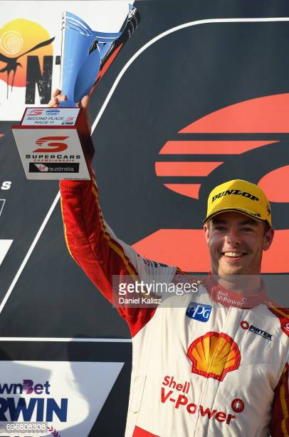 2nd place Scott McLaughlin driver of the Shell VPower Racing Team Ford Falcon FGX celebrates on the podium after race 11 for the Darwin Triple Crown...
