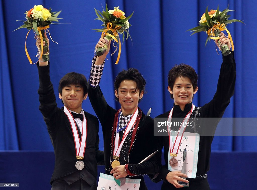 2nd place winner Nobunari Oda winner Daisuke Takahashi and 3rd place winner Takahiko Kozuka pose on the podium after competing in the Men Free...