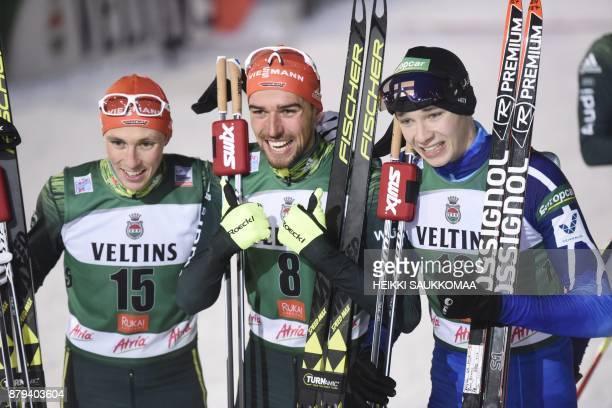 2nd placed Eric Frenzel of Germany winner Johannes Rydzek of Germany and 3rd placed Eero Hirvonen of Finland pose after the Nordic Combined Men's...