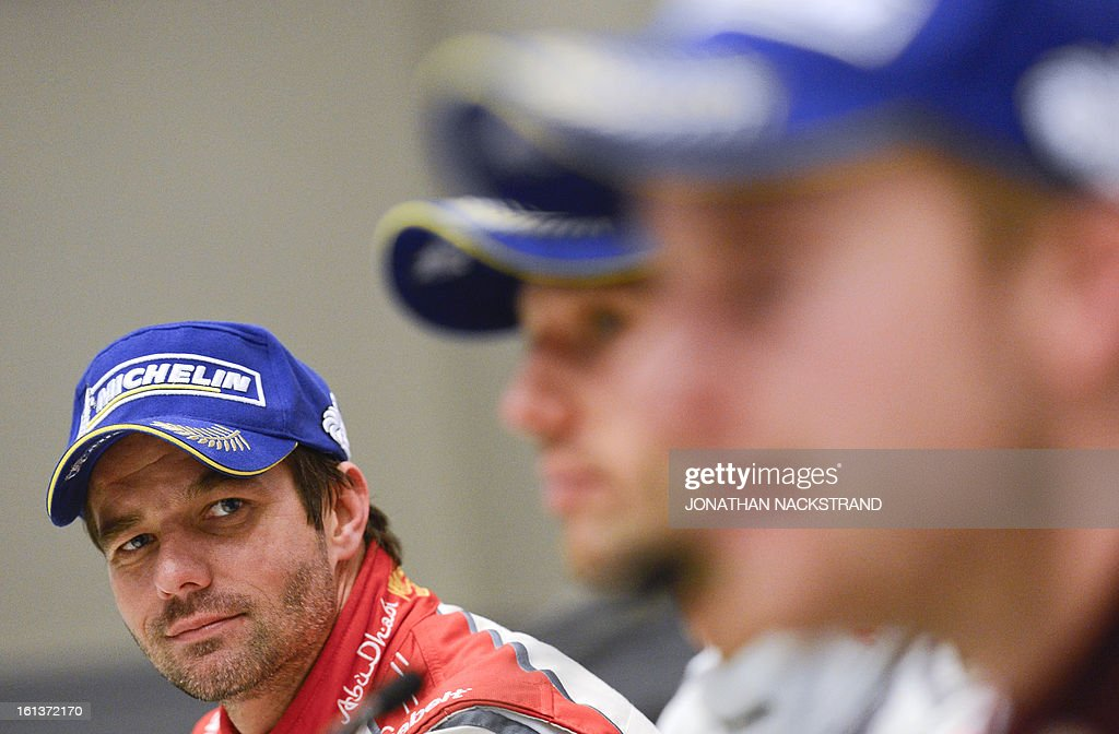 2nd placed France's Sebastien Loeb (L) is pictured during a press conference of Rally Sweden, second round of the FIA World Rally Championship on February 10, 2013 in Karlstad, Sweden.