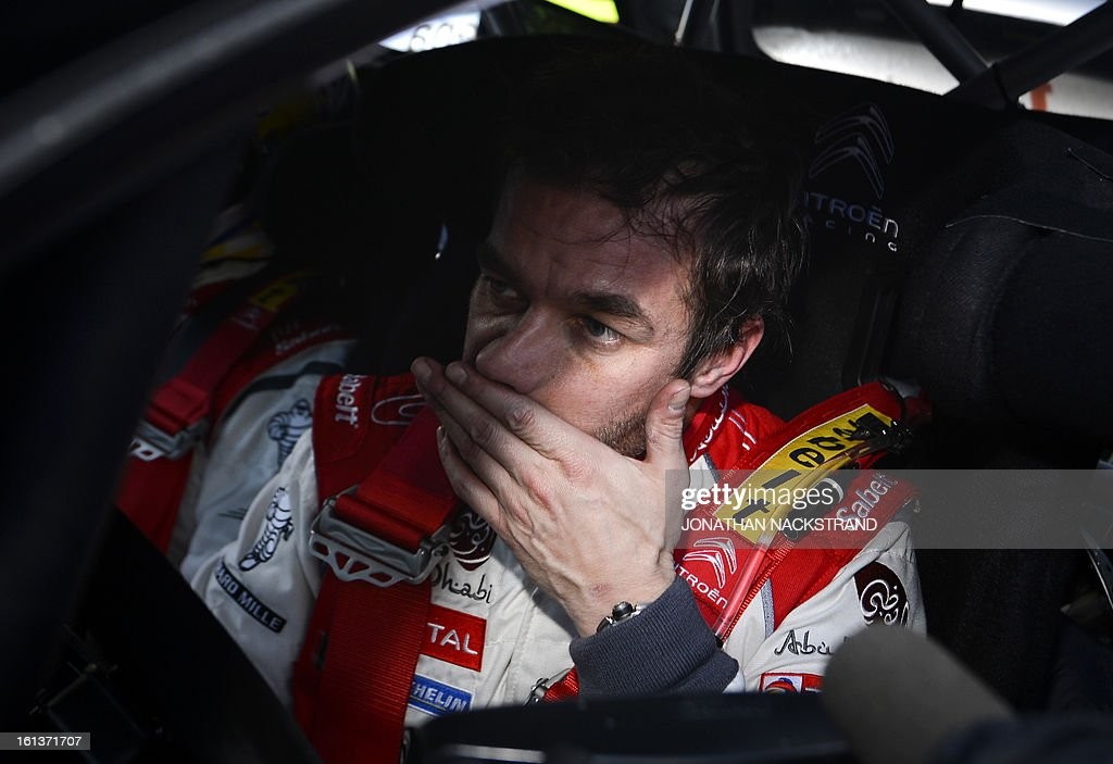 2nd placed France's Sebastien Loeb reacts after crossing the finish line of the 22nd and the last stage of Rally Sweden, FIA World Rally Championship second round in Karlstad, Sweden on February 10, 2013. AFP PHOTO/JONATHAN NACKSTRAND
