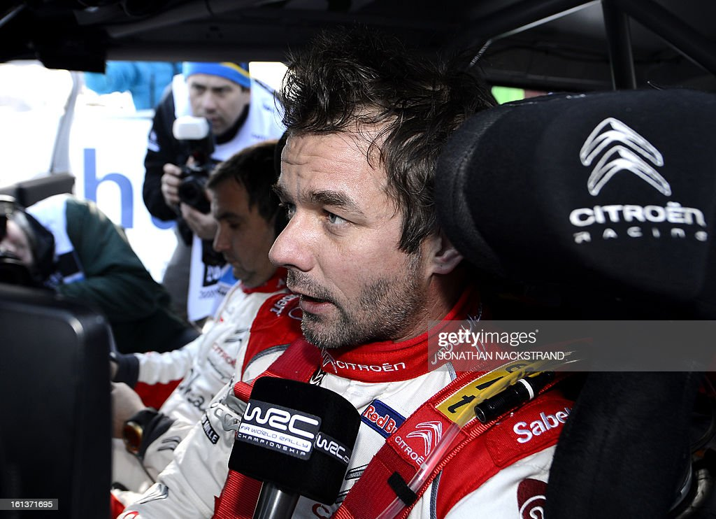 2nd placed France's Sebastien Loeb speaks to journalists after crossing the finish line of the 22nd and the last stage of Rally Sweden, FIA World Rally Championship second round in Karlstad, Sweden on February 10, 2013. AFP PHOTO/JONATHAN NACKSTRAND