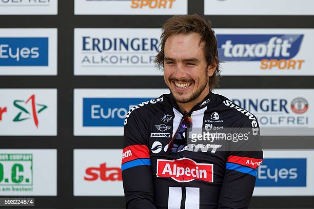 2nd placed John Degenkolb is honored in the ceremony at the Euroeyes Cyclassics Hamburg on August 21 2016 in Hamburg Germany