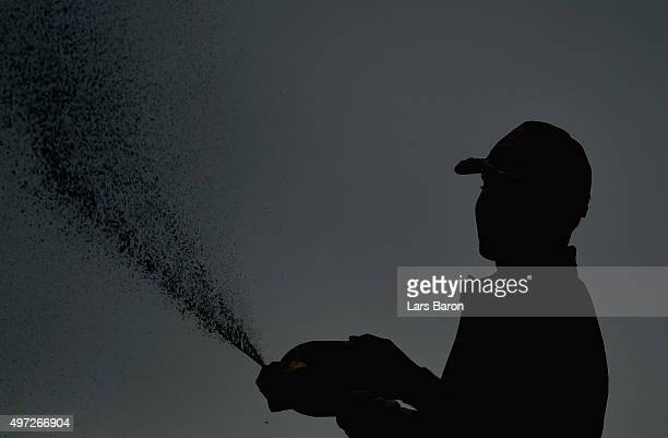 2nd placed Lewis Hamilton of Great Britain and Mercedes GP sprays champagne after the Formula One Grand Prix of Brazil at Autodromo Jose Carlos Pace...