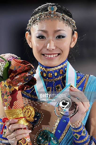 2nd placed Miki Ando of Japan poses with her medal after competing in the Ladies Free Skating on the day three of ISU Grand Prix of Figure Skating...