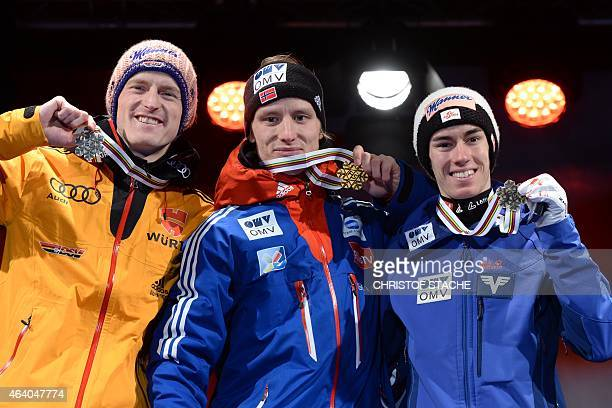 2nd placed Severin Freund of Germany winner Rune Velta of Norway and 3rd placed Stefan Kraft of Austria pose on the podium during the medal ceremony...