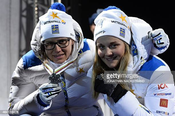 2nd placed team of Sweden Ida Ingemarsdotter and Stina Nilsson pose on the podium during the medal ceremony after competing in the ladies...