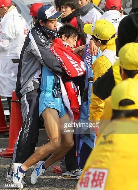 2nd runner of Tokai University Akinobu Murasawa is carried after passing the sash in day one of the 88th Hakone Ekiden on January 2 2012 in Yokohama...