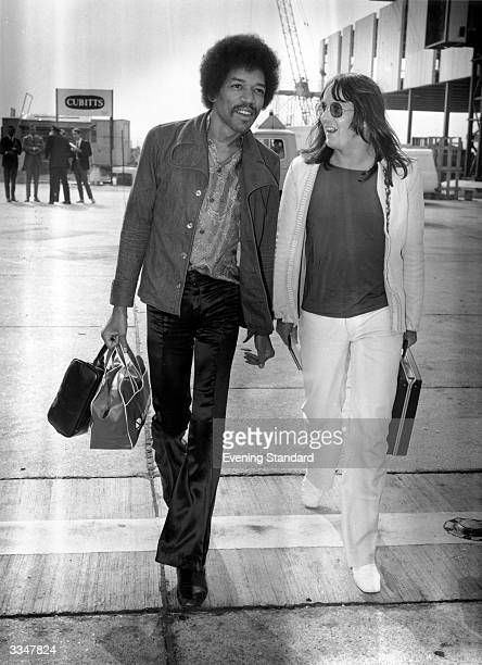 Influential rock guitarist Jimi Hendrix arriving at London Airport with Eric Barrett