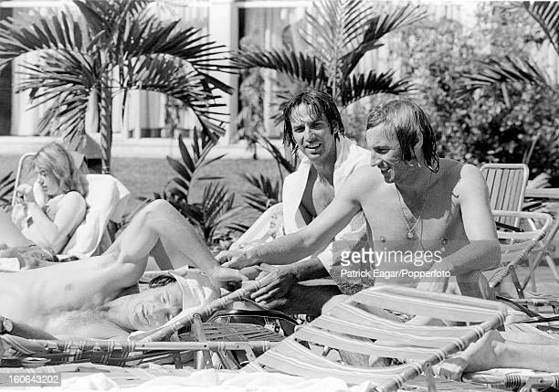 2nd Test India v England at Calcutta 1977 Keith Fletcher Mike Selvey and John Lever relax by the pool at the Centaur Hotel Bombay en route for Madras