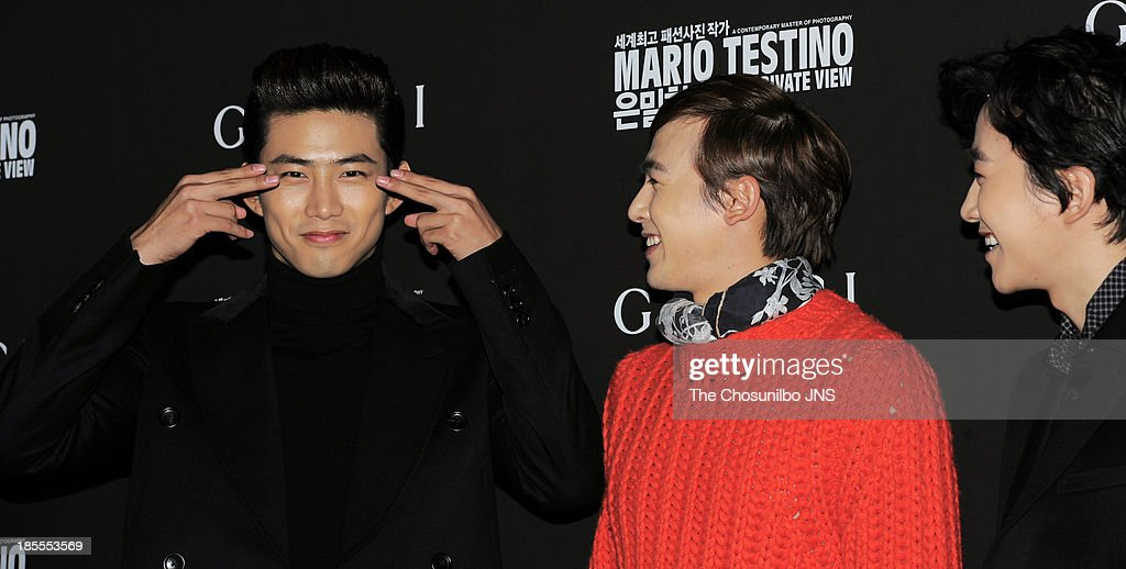 2pm attend the 'Mario Testino: Private View' Photographic Exhibition Opening at GUCCI flagship store on October 18, 2013 in Seoul, South Korea.
