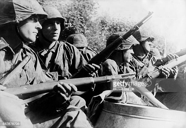 2ww campaign in the west 1940 engineer soldiers of WaffenSS mounted on vehicle entering Guerbigny Sommeabout